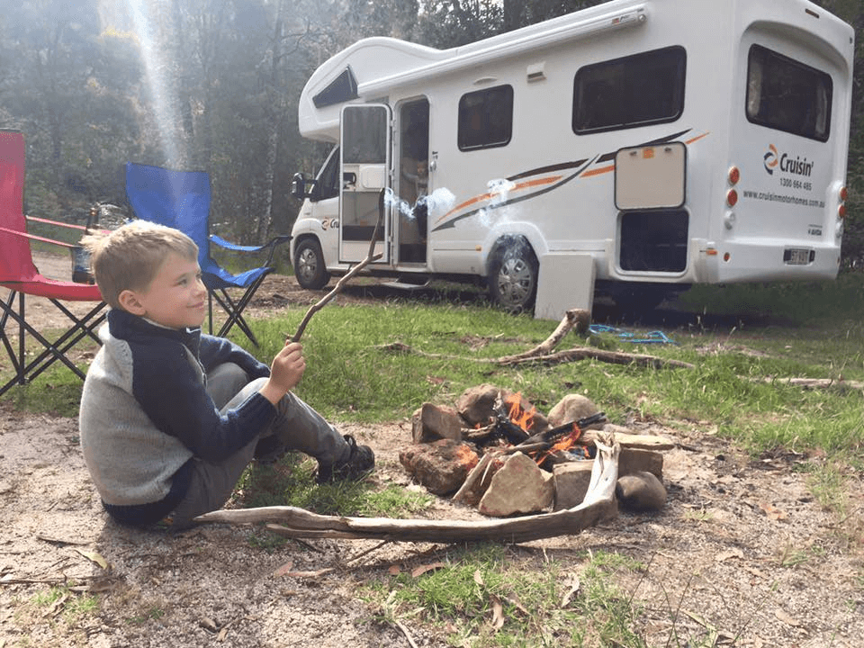 Kid by Fire Outdoor Camping